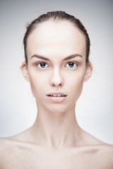 portrait of a beautiful woman with clean face skin