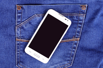 Part of cellphone on blue jeans pocket