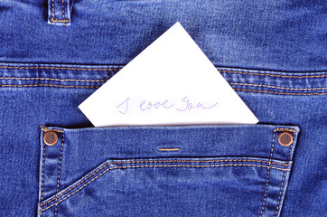 Sticker in back pocket blue jeans