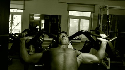 Young bodybuilder training in a gym