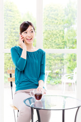 young asian woman relaxing in the cafe