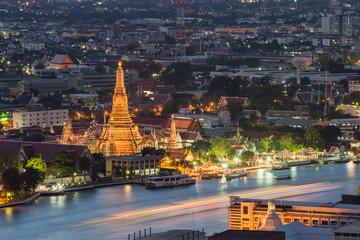 Night view of Wat Arun temple and Chao Phraya River, Bangkok, Th