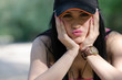 Постер, плакат: Lady with black athletic hat and pink short top