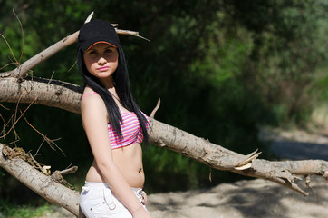 Lady with black athletic hat and pink short top