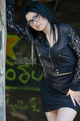 Round face lady with glasses and black clothes