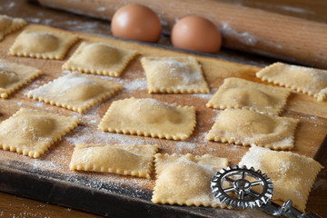Raw Agnolotti Pasta On Cutting Board