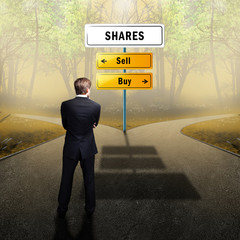 businessman has to choose between buy and sell shares