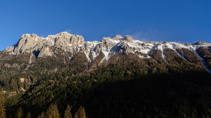 Dolomite Alps, mountain ridge, snow blown over summit, high wind