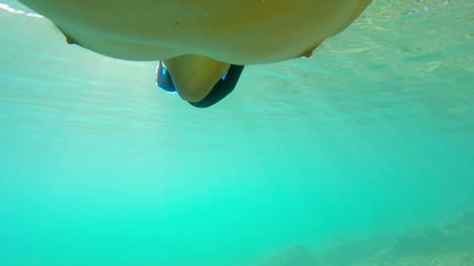 Swimming underwater with diving mask