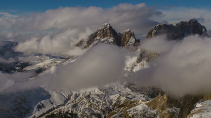 Sasso Lungo peak covered in clouds winter time lapse