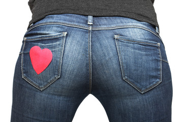 Girl's bum with heart-shaped post-it on her jeans pocket
