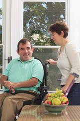 Couple with Cerebral Palsy socializing on their deck