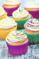 Mardi Gras cupcakes with butter cream frosting