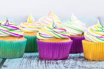 Colorful homemade Mardi Gras cupcakes with butter cream frosting