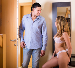 Girl in underwear meeting husband