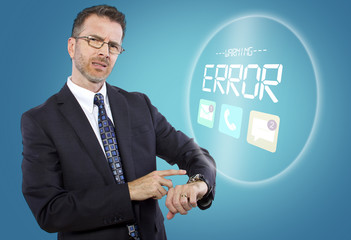 caucasian businessman confused by new smart watch technology