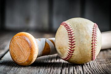 Baseball ball and a wooden stick