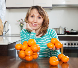 Happy girl with mandarines