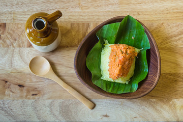 Sticky rice with shrimp and herb on banana leaf