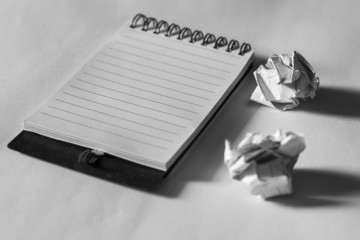 note paper with crumpled paper