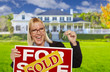 Excited Woman Holding House Keys and Sold Real Estate Sign