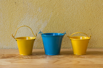 Vintage still life with bucket and grunge background