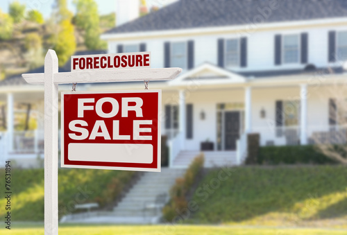 Leinwandbild Motiv Foreclosure Home For Sale Sign in Front of Large House