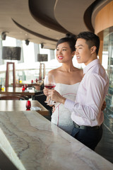 Beautiful couple with wine glasses