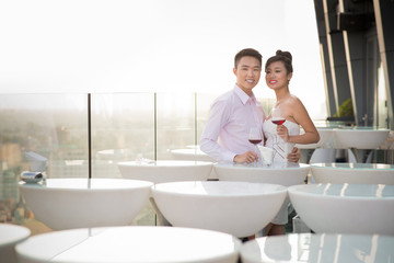 Adorable couple in the rooftop restaurant
