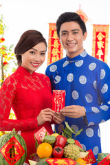 Vietnamese couple with greeting card