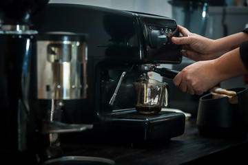 coffee machine with hand in processing