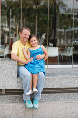 Cheerful man and his daughter