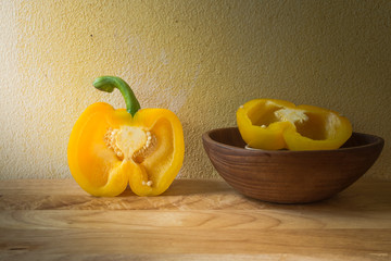 Vintage still life with bell pepper and grunge background