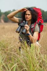 Traveler with binoculars