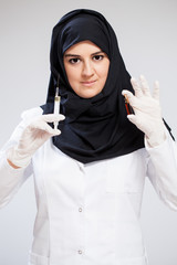 Muslim doctor with a syringe