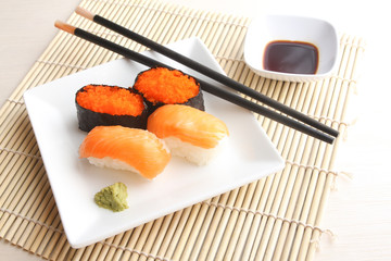 Salmon and flying fish roe sushi on plate