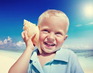 Little Boy Beach Seashell Fun Vacation Concept