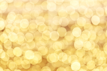 Yellow defocused glitter background with copy space