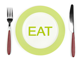 Plate with word EAT on it, fork and knife isolated on white