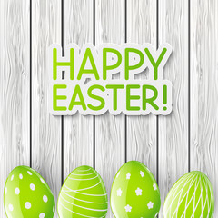 Easter greeting card with green eggs