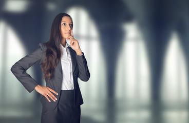 Thoughtful stylish businesswoman