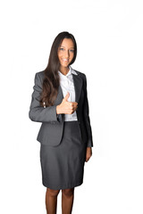 Smart young businesswoman giving a thumbs up