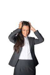 Businesswoman tearing at her hair in frustration