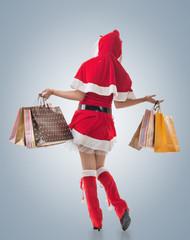 Christmas girl holding shopping bags