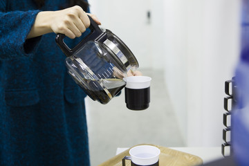 Women who are pouring office coffee
