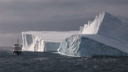 Cruise ship in front of ice berg in Antarctica