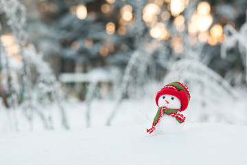 Snowman in a winter forest, Christmas decoration