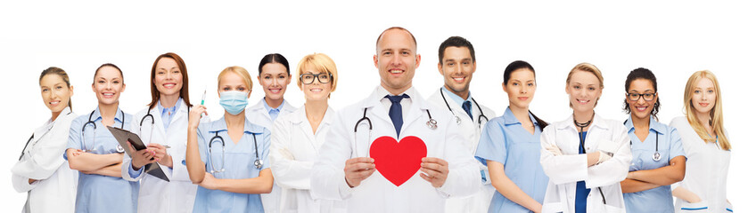 group of smiling doctors with red heart shape