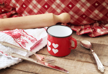 Valentines concept with hearts decorated mug and kitchen utensil