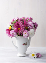 Still life with colourful chrysanthemums bunch on   wooden board